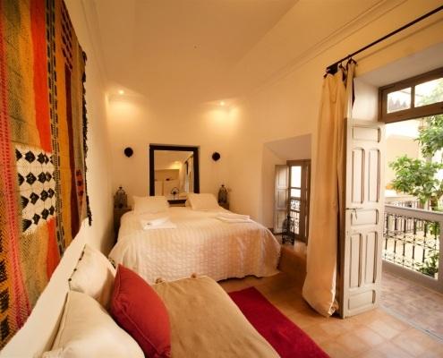 Chambre R'kia rouge, orange et taupe du Riad Dar Aman à Marrakech Maroc