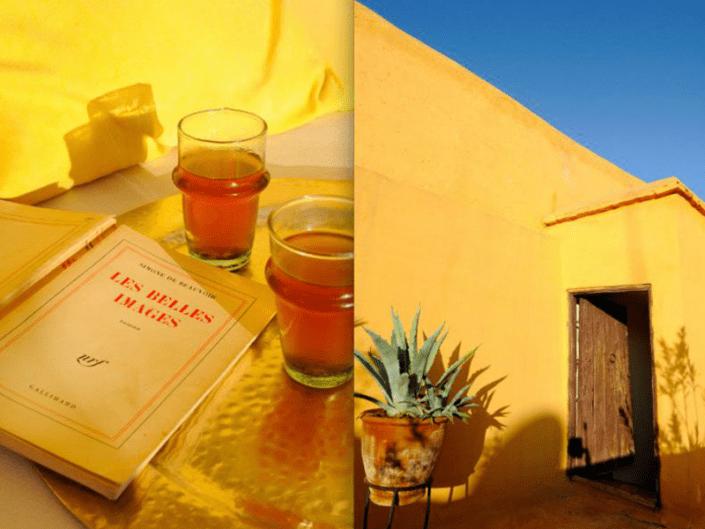Photo d'un livre et du thé à la menthe sur une terrasse aux murs ocre dans un riad à Marrakech